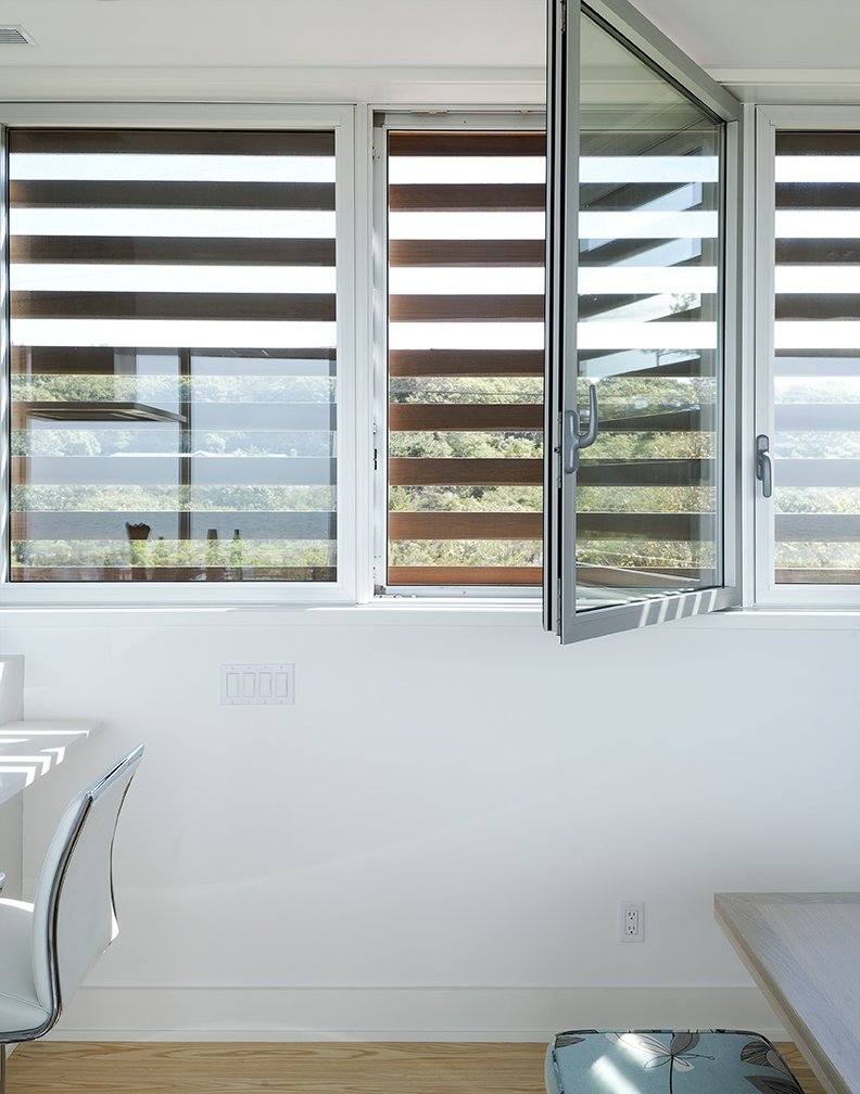 Cedar louvers veil hurricane windows by Solar Innovations. Tagged: Windows and Metal.  North Sea House by Dwell from Shore Bet