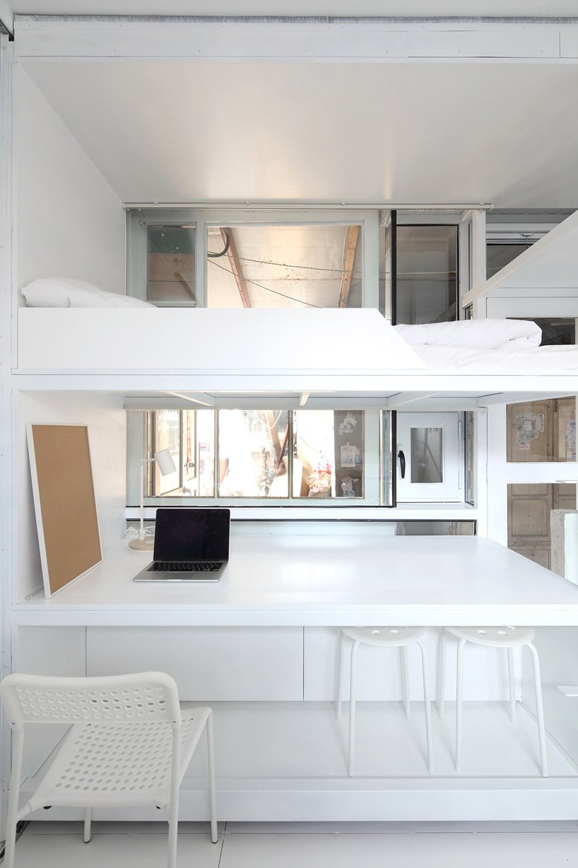 Humble Hostel was conceived by a group of young people who proposed temporary housing that could also give back space usually taken up by kitchen areas, bicycle parking, and other junk. Tagged: Bedroom, Bunks, and Chair.  Photo 3 of 7 in 6 Well-Designed Hostels For the Minimalist Traveler