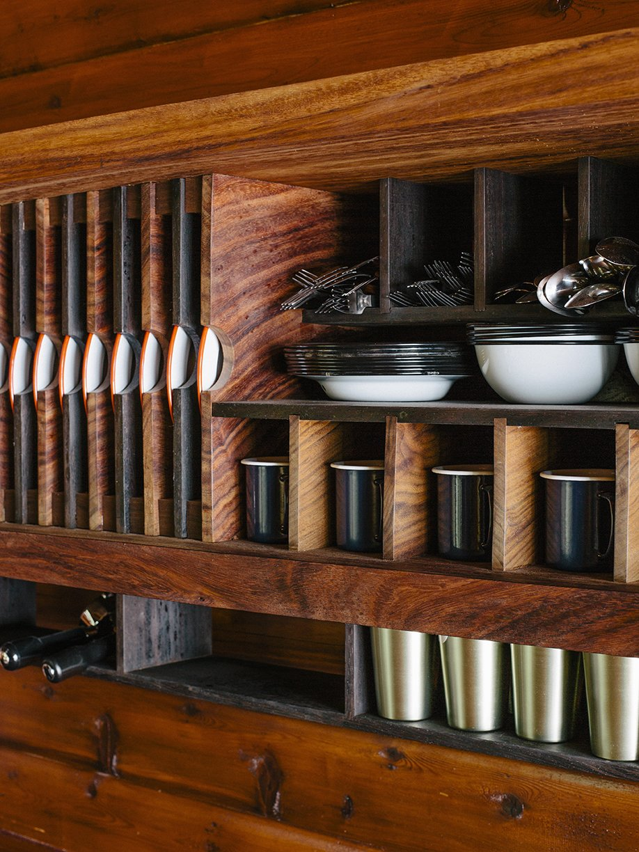 The kitchen was designed like a ship, with built-in storage created by Conrad Contracting. Tagged: Storage Room and Shelves Storage Type.  Photo 6 of 13 in An Eclectic Pacific Northwest Cottage