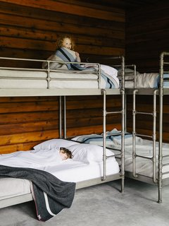 An Eclectic Pacific Northwest Cottage - Photo 7 of 13 - Bruce sourced the Restoration Hardware bunk beds (Mina, 3, claims top).