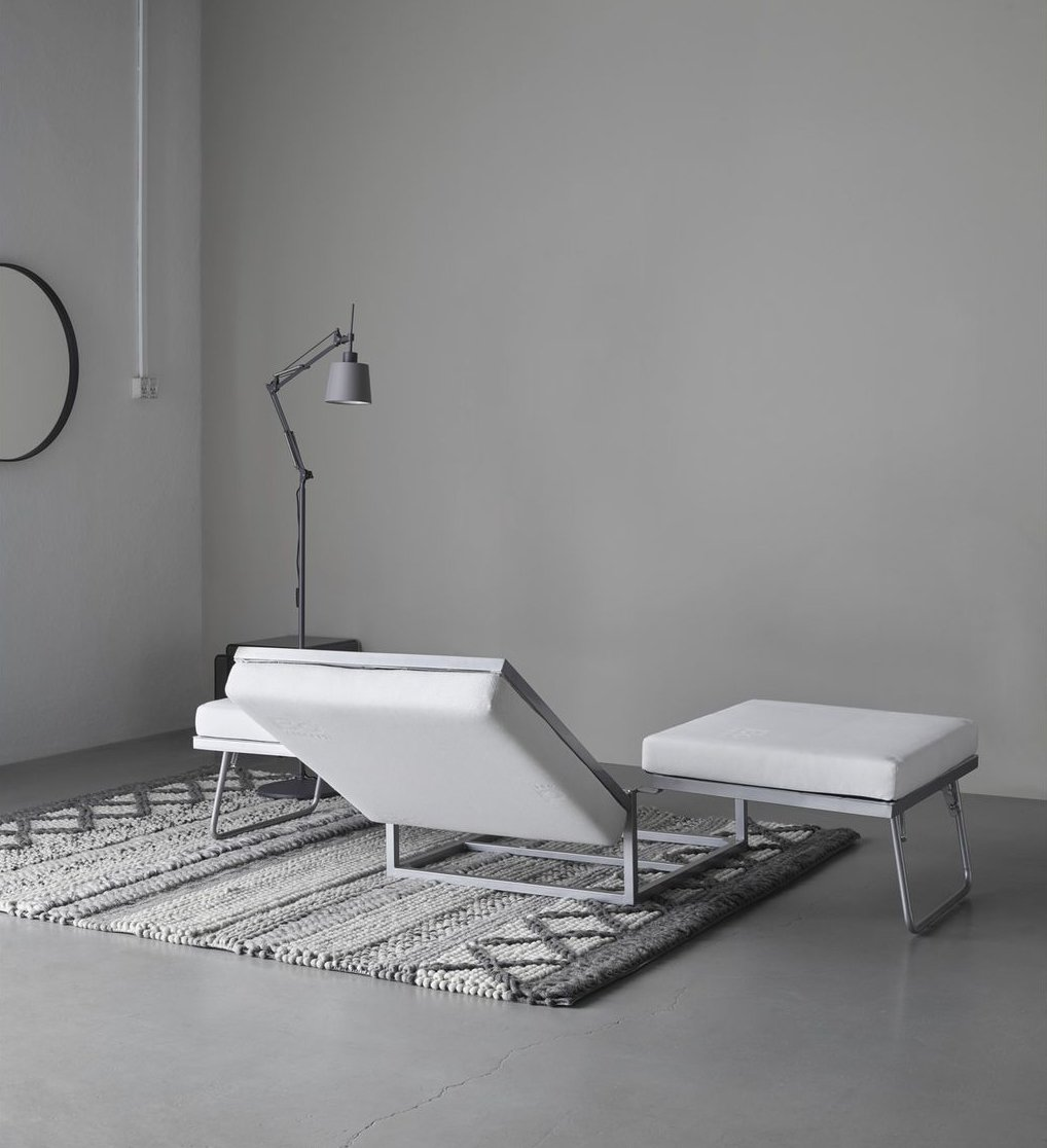 The Extra ottoman in motion. Tagged: Bedroom, Bed, Rug Floor, and Floor Lighting.  Photo 7 of 12 in 10 Functional Pieces For Small Space Living