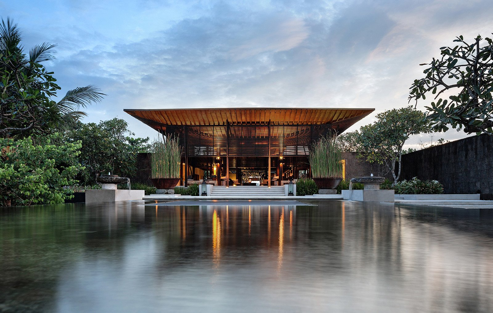 Tagged: Outdoor, Walkways, Back Yard, Swimming Pools, Tubs, Shower, Hardscapes, Trees, Garden, Gardens, Large Pools, Tubs, Shower, Concrete Fences, Wall, and Infinity Pools, Tubs, Shower.  Photo 1 of 9 in A Modern Bali Resort That's Inspired by the Local Landscape and Culture