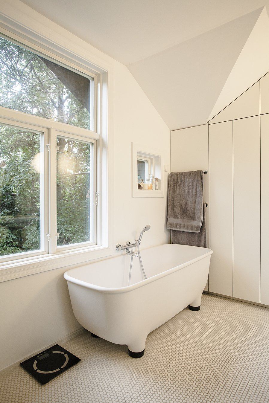 The footed bathtub in the completely renovated bathroom is by Marc Newson for Caroma. Skibsted Residence by Dwell