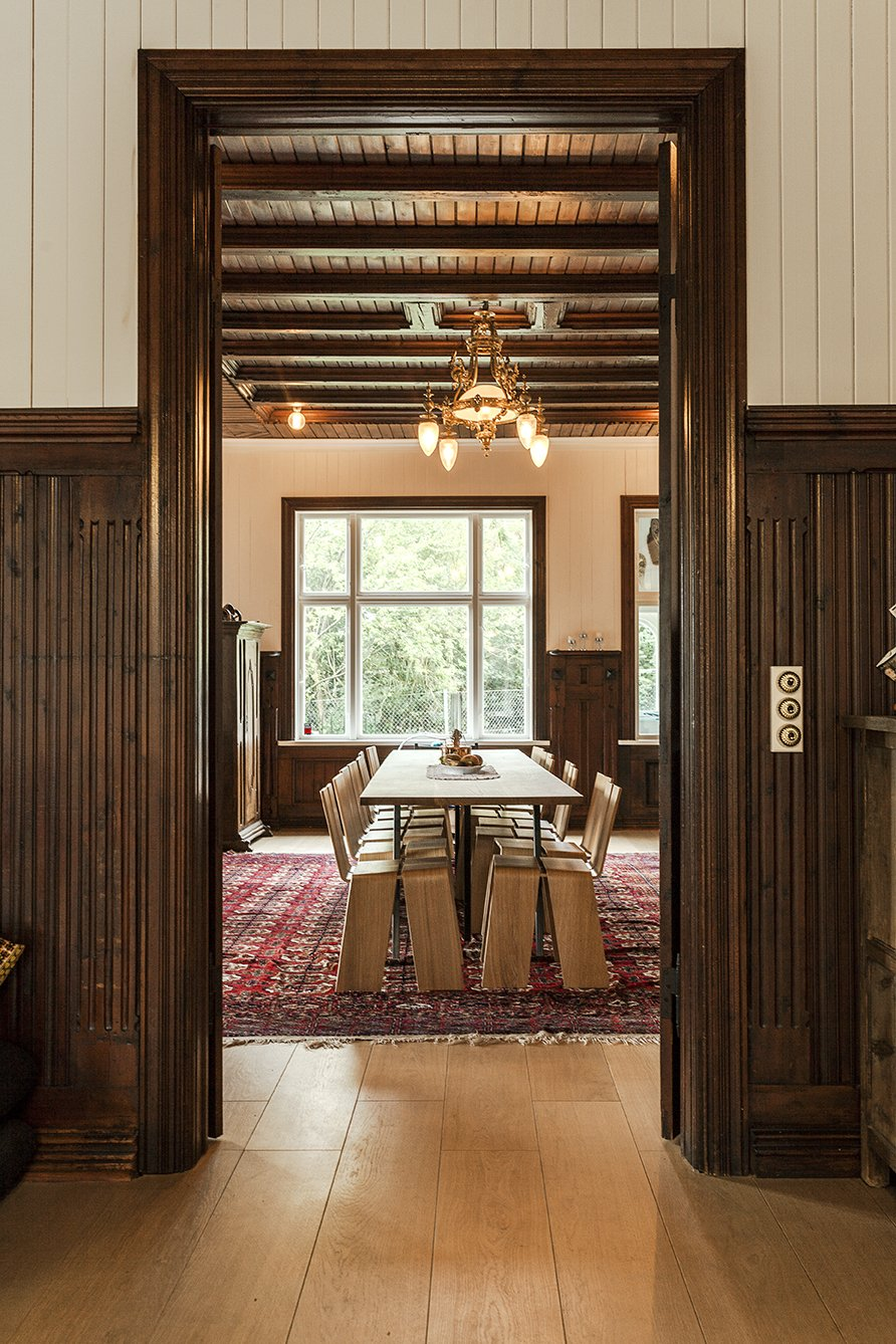 Another view of the dining room reveals the original woodwork and character of the 19th-century structure.  Skibsted Residence by Dwell
