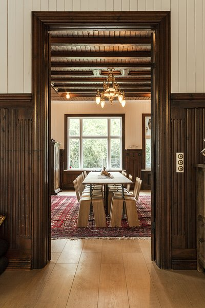 Another view of the dining room reveals the original woodwork and character of the 19th-century structure. Photo 8 of Skibsted Residence modern home
