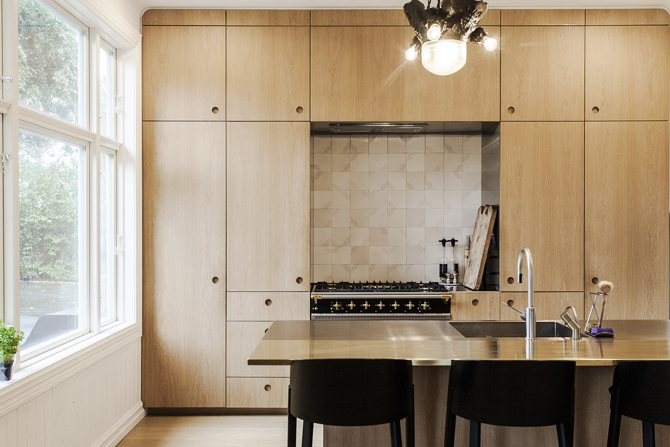 In the renovated kitchen, a Lacanche range is surrounded by built-in storage. A state-of-the-art wall-mounted ES2 Strietman brass-and-copper espresso maker by Dutch designer Wouter Strietman adds a jewelry-like touch to the cook space.   Skibsted Residence by Dwell