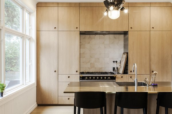 In the renovated kitchen, a Lacanche range is surrounded by built-in storage. A state-of-the-art wall-mounted ES2 Strietman brass-and-copper espresso maker by Dutch designer Wouter Strietman adds a jewelry-like touch to the cook space.  Photo 9 of Skibsted Residence modern home