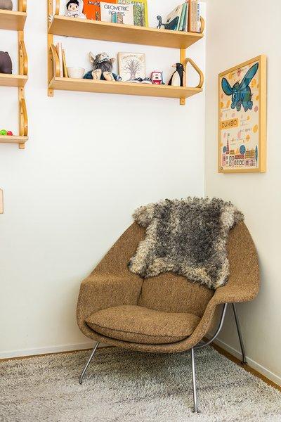 In daughter Elliot's room, a vintage Womb chair by Eero Saarinen is situated below Alvar Aalto 112 sheIn daughter Elliot's room, a vintage Womb chair by Eero Saarinen is situated below Alvar Aalto 112 shelving scored on eBay.