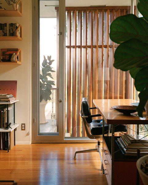 """The den's first-production Eames Desk Unit (EDU) was """"rescued"""" from a Gregory Ain house. Photo 5 of The Romano-Ferrer Residence modern home"""