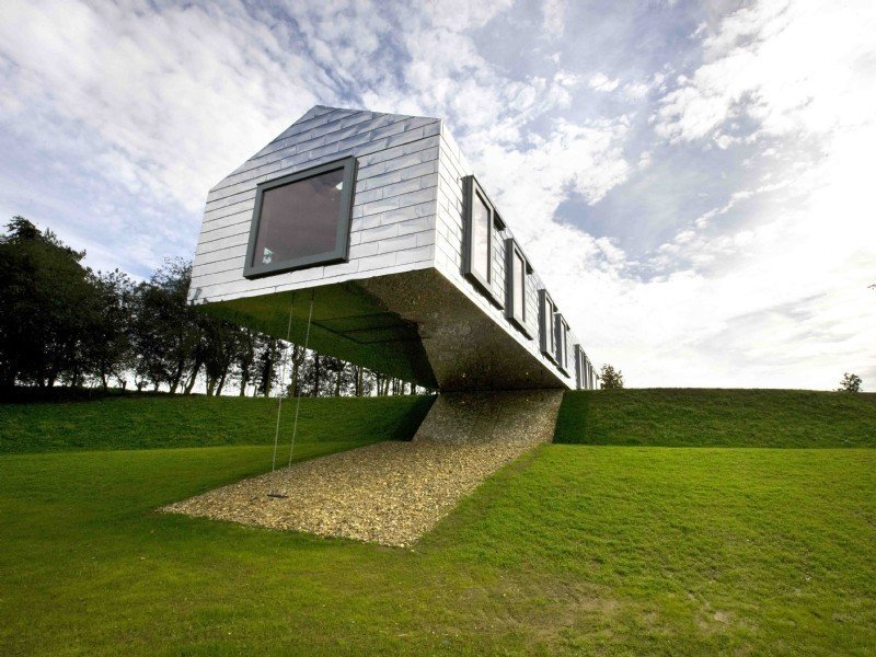 Tagged: Outdoor, Slope, Grass, and Trees.  Photo 3 of 11 in Take a Modern British Holiday in a Gleaming Cantilevered Barn