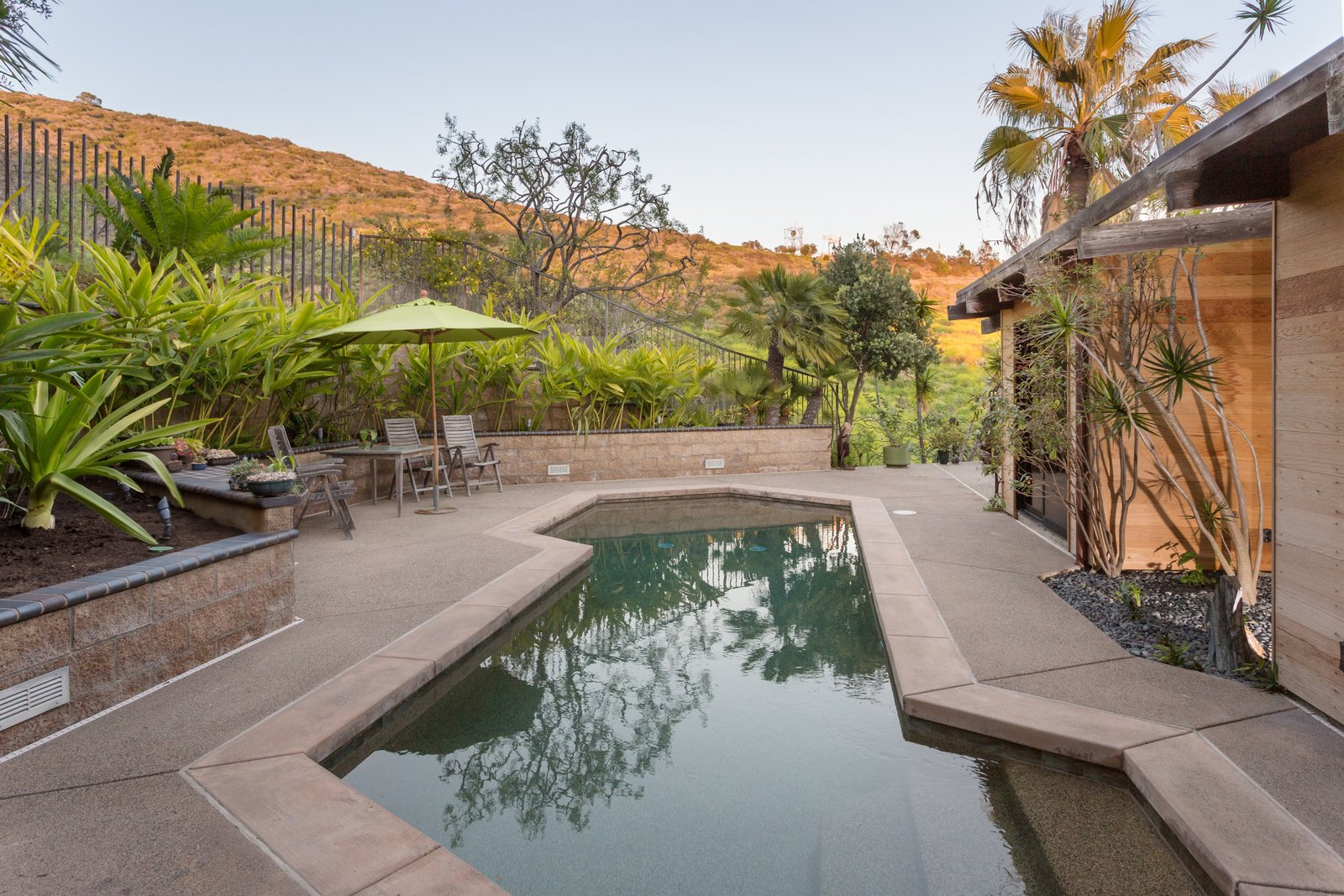 Tagged: Outdoor, Plunge Pools, Tubs, Shower, Shrubs, Trees, Concrete Patio, Porch, Deck, and Back Yard.  Photo 12 of 13 in A 1974 Masterpiece Is Put on the Market by a Family Friend of the Late Julius Shulman