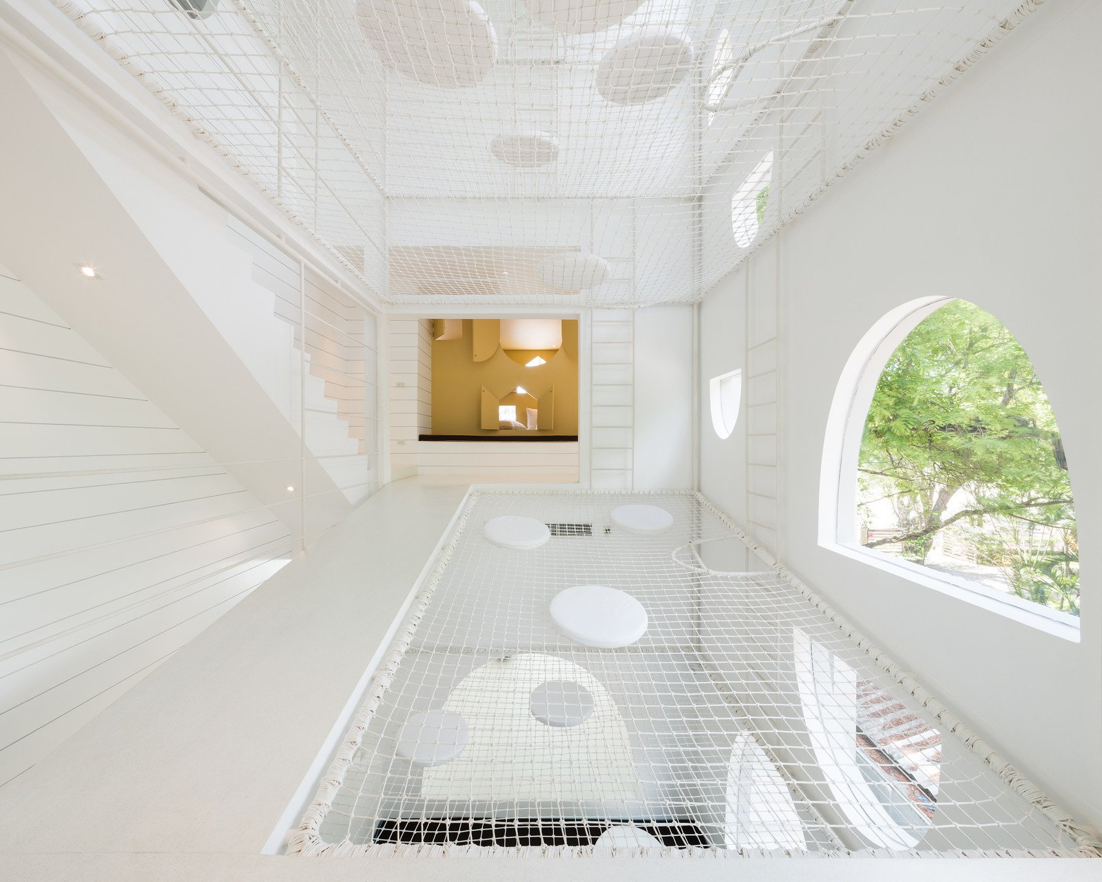 Photo 1 of 11 in Inspired by Tom and Jerry, This Net-Filled Vacation Home Is a Kid's Paradise