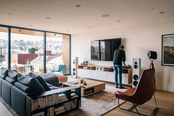Modern home with living room. Sonos speakers are wired throughout the house, complemented  by Magico S3 standing speakers in  the family room. The leather Lama lounger is by Ludovica  and Roberto Palomba for Zanotta. Photo 13 of Conrad Residence