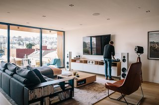 Domino Effect: How a Bedroom Refresh Jump-Started a Whole-House Remodel For a Tech Exec - Photo 12 of 14 - Sonos speakers are wired throughout the house, complemented by Magico S3 standing speakers in the family room. The leather Lama lounger is by Ludovica and Roberto Palomba for Zanotta.