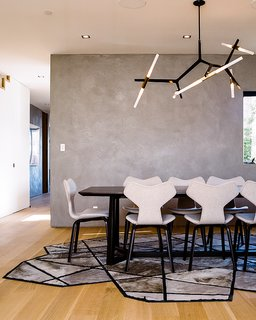 Domino Effect: How a Bedroom Refresh Jump-Started a Whole-House Remodel For a Tech Exec - Photo 10 of 14 - Fritz Hansen Grand Prix chairs, a Lindsey Adelman Agnes Chandelier, and a Kyle Bunting Runway rug furnish the dining room.