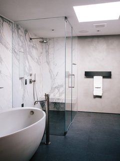 Domino Effect: How a Bedroom Refresh Jump-Started a Whole-House Remodel For a Tech Exec - Photo 6 of 14 - In the master bathroom, a freestanding Waterworks tub is paired with a Fantini fixture. Calacatta marble surrounds the shower; the flooring is Evolution ceramic tile from Apavisa.