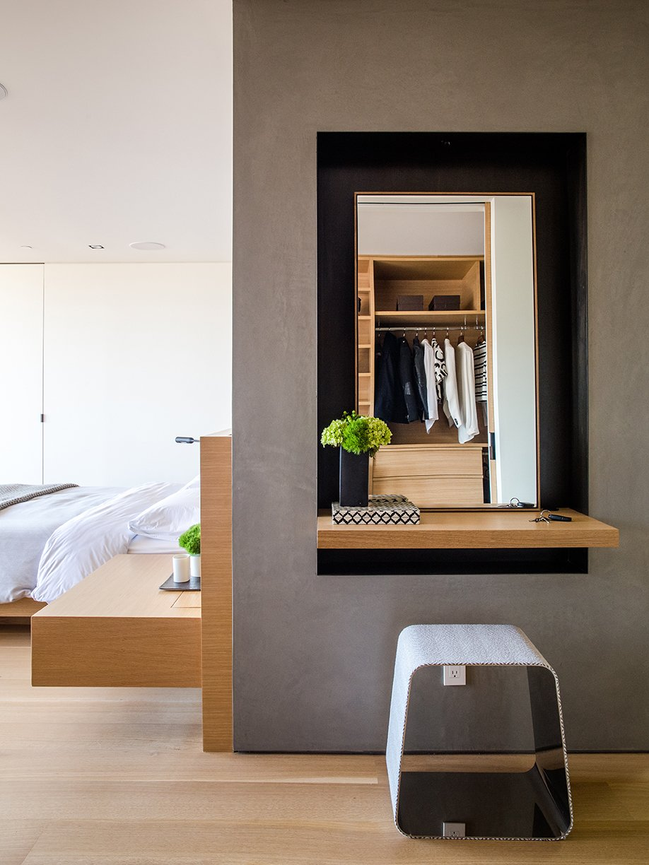 Like the bed and built-in nightstand, the door is by Lloyd's Custom Woodwork. The WGS stool near the vanity is by Gallotti&Radice. Tagged: Storage Room and Closet Storage Type.  Photo 6 of 15 in Domino Effect: How a Bedroom Refresh Jump-Started a Whole-House Remodel For a Tech Exec