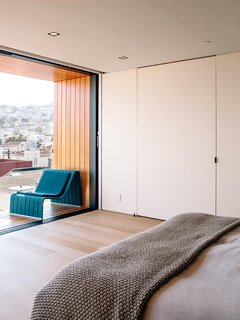 Domino Effect: How a Bedroom Refresh Jump-Started a Whole-House Remodel For a Tech Exec - Photo 4 of 14 - A special media door opens to reveal the bedroom's AV system.