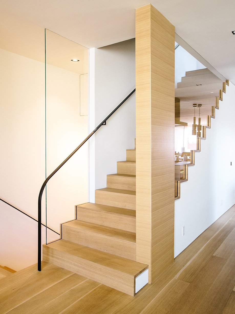The staircase  follows the bedroom's new primary material, French white oak. Tagged: Staircase, Wood Tread, and Metal Railing. Domino Effect: How a Bedroom Refresh Jump-Started a Whole-House Remodel For a Tech Exec - Photo 4 of 15
