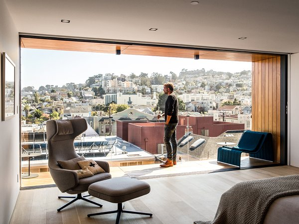 Tom Conrad and Kate Imbach's first bedroom redo creates as many problems as it alleviated, blocking their view of Noe Valley behind a wall, for instance. Their second attempt, shown here, opened up the balcony, which has a Frame lounge by Francesco Rota for Paola Lenti. A Grand Repos chair by Antonio Citterio for Vitra faces the bed.