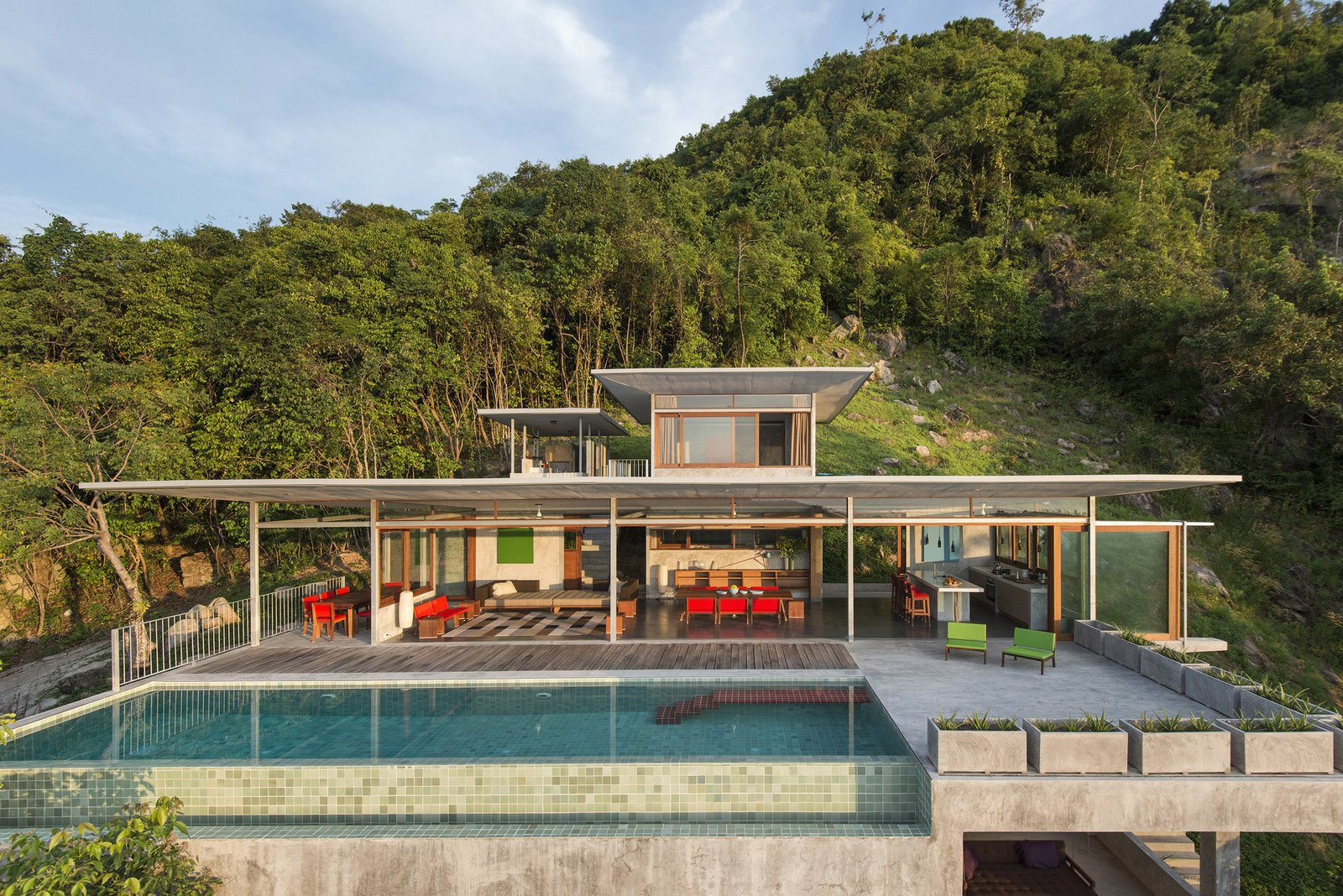 Tagged: Outdoor, Grass, Infinity Pools, Tubs, Shower, Slope, Swimming Pools, Tubs, Shower, Trees, Raised Planters, Back Yard, Concrete Patio, Porch, Deck, and Metal Fences, Wall.  Photo 1 of 11 in Take a Trip to This Photographer-Designed Concrete Home in Thailand