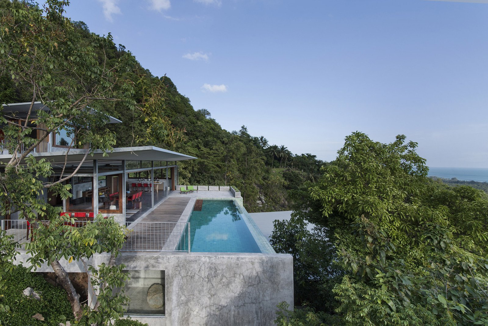 Tagged: Infinity Pools, Tubs, Shower, Wood Patio, Porch, Deck, Trees, Back Yard, Metal Fences, Wall, and Outdoor.  Photo 5 of 11 in Take a Trip to This Photographer-Designed Concrete Home in Thailand