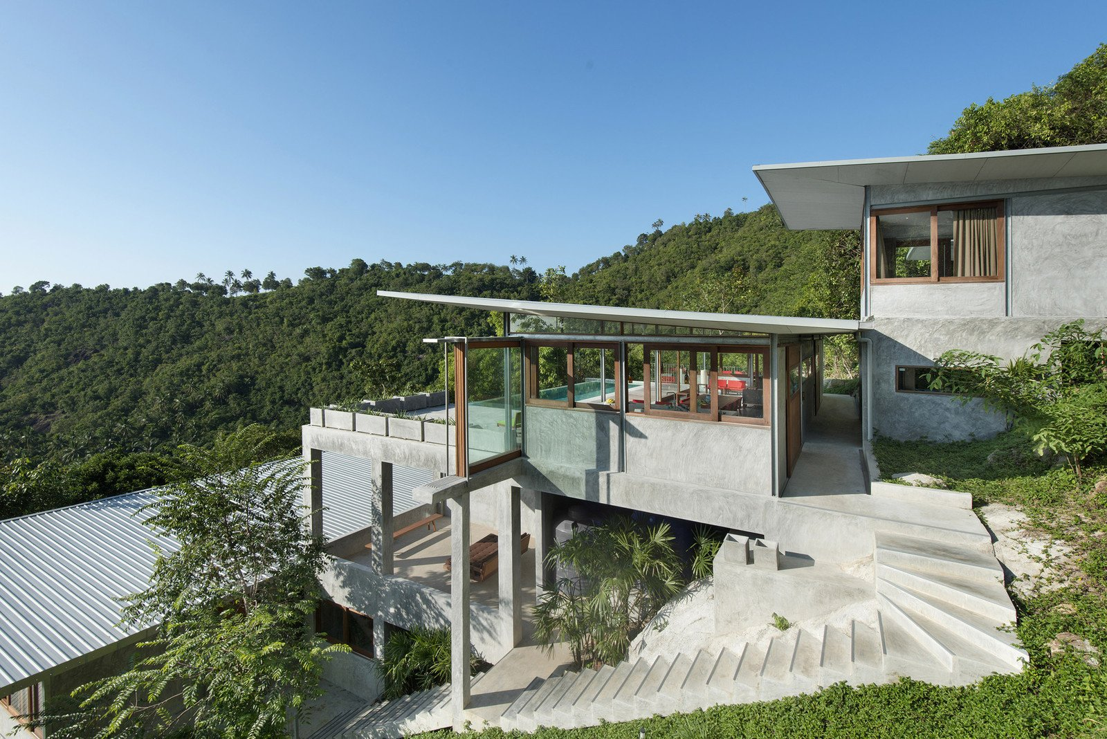 Tagged: Sofa, Bed, Trees, Metal, Side Yard, Cooktops, Freestanding, Enclosed, One Piece, Outdoor, Slope, Shrubs, Walkways, and Grass.  Best Outdoor One Piece Cooktops Photos from Take a Trip to This Photographer-Designed Concrete Home in Thailand