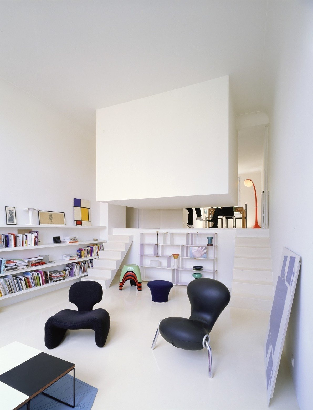 The bedroom in this conversion of a former artist's studio is literally concealed in a white box suspended from the ceiling and located just off the living room. Designed by Emmanuel Combarel Dominique Marrec Architects, the bedroom is  Photo 9 of 16 in Gestalten's New Book Shows How to Transform Small Spaces Into Design Marvels