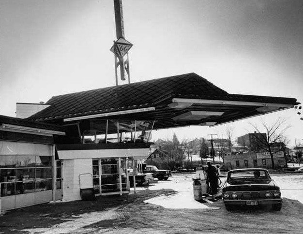The building features a cantilevered copper canopy and is primarily made of concrete, glass, and steel. There's a glass observation lounge on the second floor for community interaction. Cypress, one of Wright's favorite materials, is used throughout the interior. Photo circa 1963. Frank Lloyd Wright's Little Known Gas Station For the Future - Photo 2 of 3
