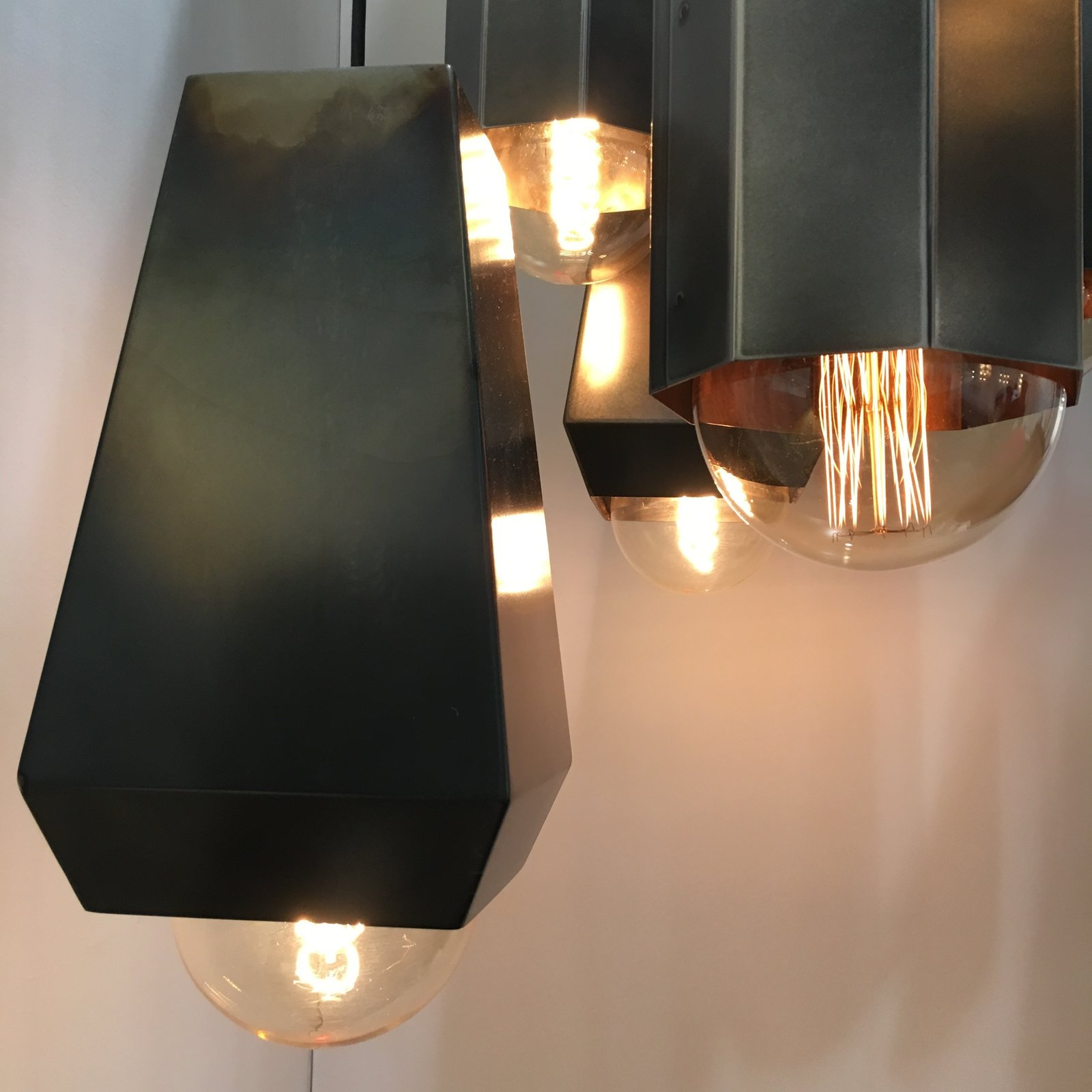 The Hex Light, constructed of steel, is stained and buffed by hand by John Beck Steel.
