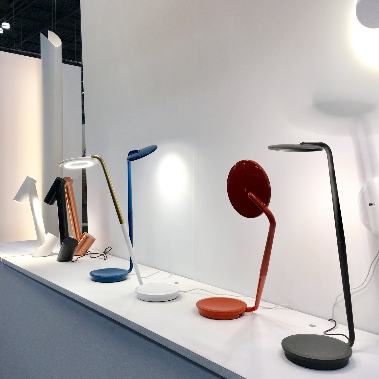 Pablo Designs displayed a wealth of product from heavy-hitting designers, including Brad Ascalon, Peter Stathis, and Matthew Boykov. A few old favorites were on display too: Here we see Pixo is in the foreground, a 2012 task light that's 97% recyclable with a circular shade; Giraffa, which comes in black, white and copper, is at left. It is constructed of a CNC-machined aluminum tube and it can rotate 360 degrees.