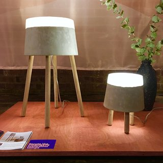 The Best of New York Design Week 2017 - Photo 28 of 35 - At WantedDesign, we spotted these winning Concrete table lamps by Renate Vos. Illuminated by LED, these pieces are comprised of concrete, silicone, and oak.