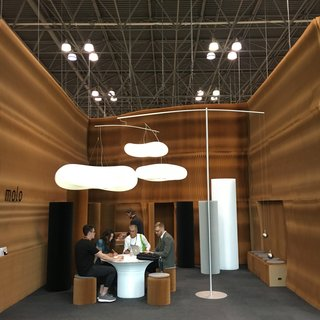 The Best of New York Design Week 2017 - Photo 30 of 35 - Molo, based in Vancouver, brought their ingenious booth system to ICFF. The walls are constructed of paper, and once the show concludes, it folds up for travel back to the studio. The cloud-like pendants are counter-balanced by hanging weights.