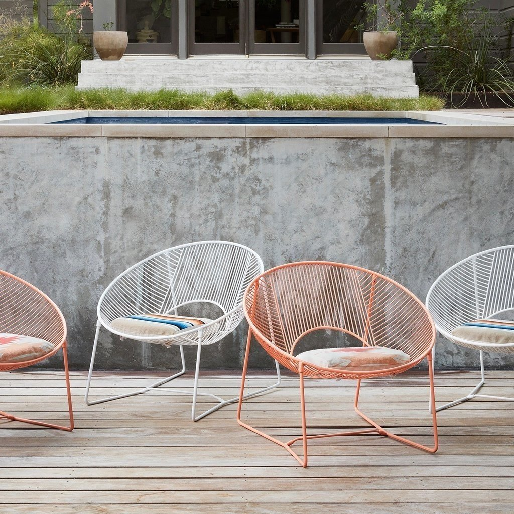 These gorgeous chairs made by the Coyoacan Design Studio are available in limited edition from the The Citizenry. Crafted from powder-coated steel they were handcrafted in Mexico City and come with a handwoven cushion made by a fair trade cooperative in Peru. Each chair takes almost two days to complete.  Photo 2 of 6 in 15 Modern Outdoor Seating Pieces To Take You Into Summer