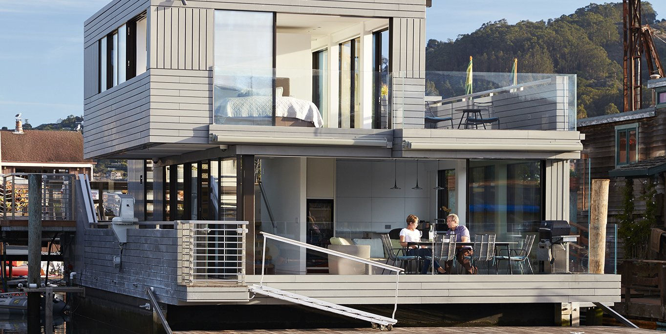 Tagged: Exterior, Wood Siding Material, House, and Flat RoofLine.  Floating Dreams Residence by Dwell from Water Sports