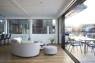 The living room furniture is from Roche Bobois.