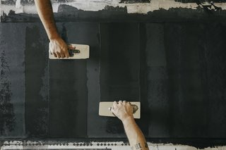 Paper Trail - Photo 6 of 16 - Coat: Using traditional Italian plaster trowels, the team applies a base coat of plaster that has been mixed with marble dust.