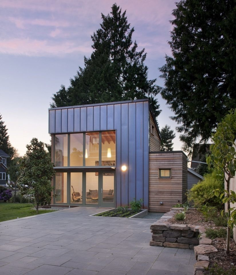 This Seattle ADU makes a modern statement that's clad in copper and cedar. The backyard Tagged: Exterior, Wood Siding Material, Flat RoofLine, Metal Siding Material, and Small Home Building Type.  Photo 1 of 16 in 8 Modern In-Law Units