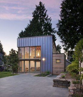 "This Seattle ADU makes a modern statement that's clad in copper and cedar. The backyard ""garden pavilion"" connects to the main house by way of an expansive slate courtyard."