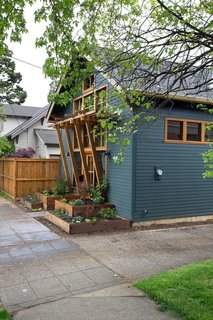 A wood trellis offers coverage and marks the entry to this 700-square-foot cottage ADU.