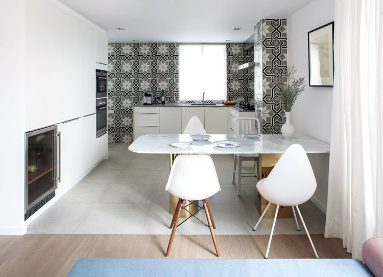 Tagged: Dining Room, Chair, Table, Recessed Lighting, Cement Tile Floor, and Medium Hardwood Floor.  Photo 2 of 7 in See How This Colorful Hong Kong Apartment Was Made to Feel Bigger Than it Actually Is