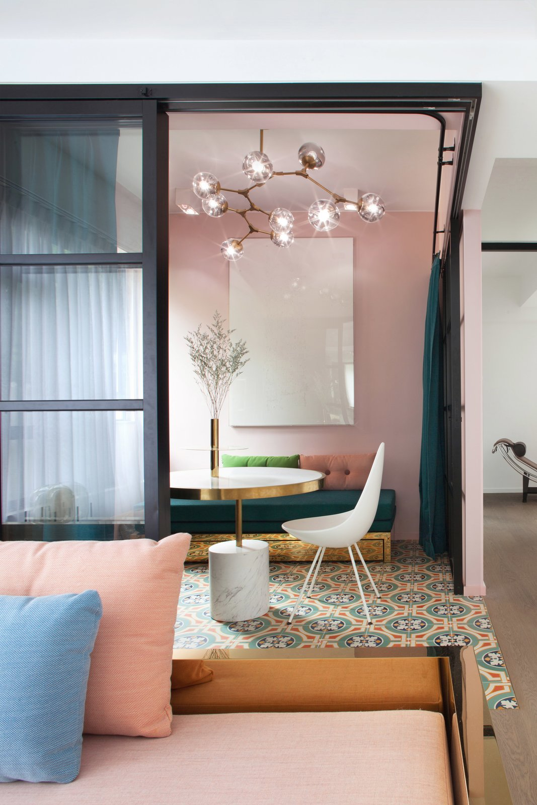 Tagged: Living Room, Coffee Tables, Chair, Bench, Ceramic Tile Floor, Ceiling Lighting, and Medium Hardwood Floor.  Photo 1 of 7 in See How This Colorful Hong Kong Apartment Was Made to Feel Bigger Than it Actually Is