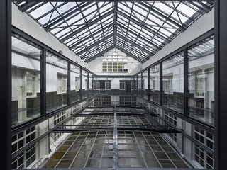 Formerly a Historic Bank, This Amsterdam Hotel Honors its Stately Roots - Photo 5 of 14 - A glass bridge traverses the atrium.