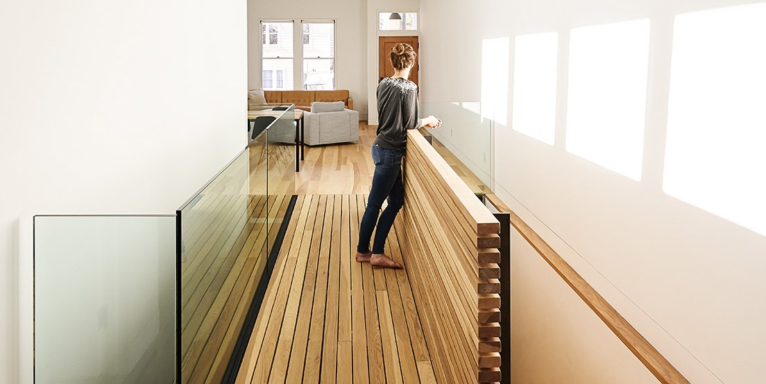 Tagged: Light Hardwood Floor, Chair, Ceiling Lighting, Table, Drop In Sink, White Cabinet, Refrigerator, Small Patio, Porch, Deck, Wall Oven, Front Yard, Hardscapes, and Hallway.  Dogpatch Cottage by Dwell
