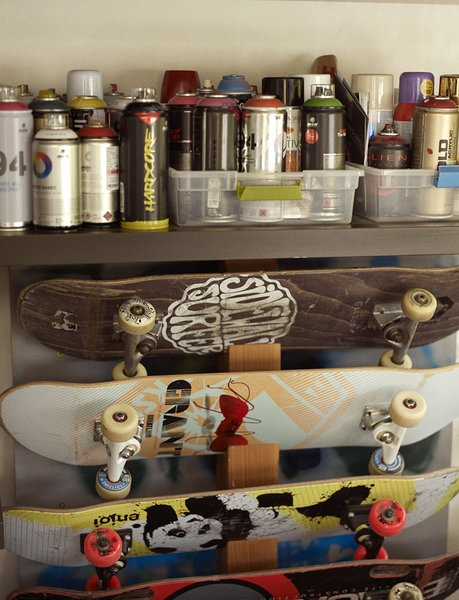 Modern home with concrete counter, den, chair, ceiling lighting, garden, gardens, flowers, concrete floor, vegetables, and storage room. In the music room, skateboards are stored below spray paints the family and friends use to decorate the skate bowl. Photo 11 of Wessel Residence