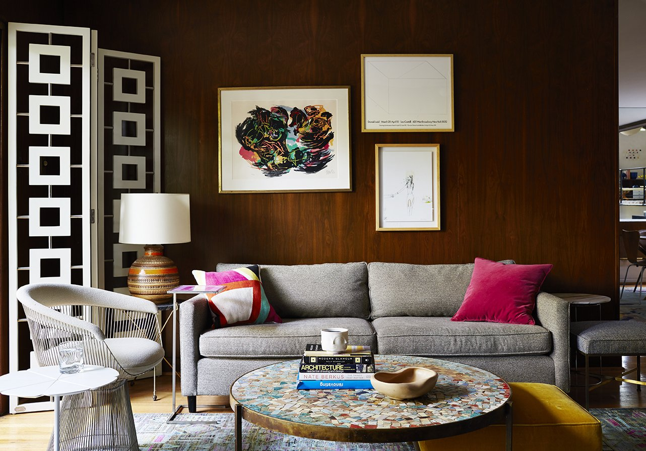 A Petal end table by Richard Schultz is paired with a Platner armchair. These classics mingle with newer items, such as a Desmond room divider by Jonathan Adler and a sofa by Mitchell Gold + Bob Williams.