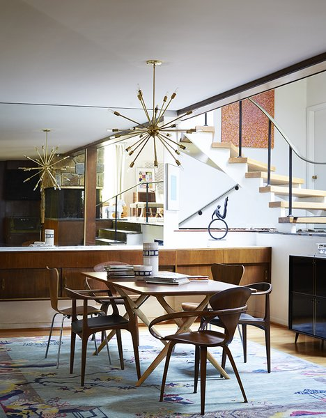 Modern home with dining room. Mostly they restored original elements, like the buffet and the staircase. Cherner chairs sit at the head of a Design Within Reach table. The armless Series 7 chairs are by Arne Jacobsen; the third pair are Juliana chairs by Aristeu Pires. Photo 4 of The Marrone/Nocera Residence