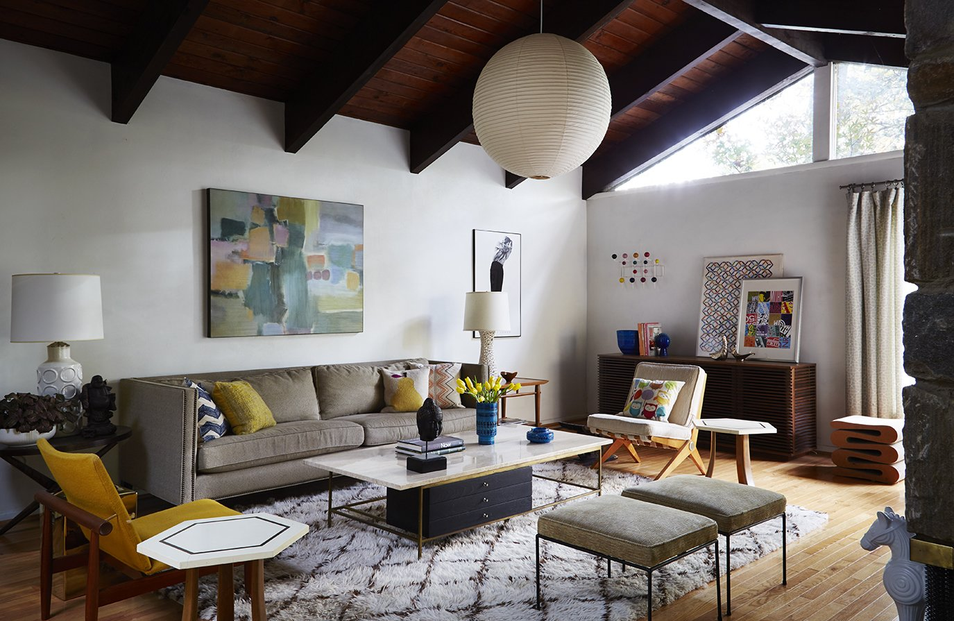 Tagged: Living Room, Sofa, Chair, Stools, Storage, Ottomans, Ceiling Lighting, Table Lighting, End Tables, Coffee Tables, Lamps, Pendant Lighting, Light Hardwood Floor, and Rug Floor.  Photo 1 of 13 in How to Update a Midcentury Modern Gem