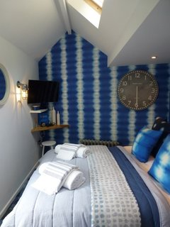9 Small Spaces With  Color - Photo 4 of 9 - Inspired by the shimmering blue sea just outside its doorstep, The Ink in the village of Saint Agnes in Cornwall is a bold, bohemian-coastal holiday retreat with tie-dye wallpapers and plenty of blue everywhere.
