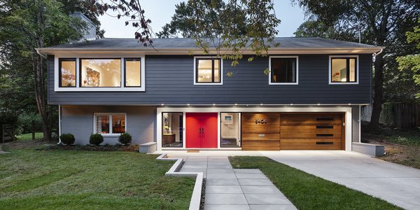 Modern home with outdoor, front yard, trees, grass, hardscapes, and walkways. Photo  of The Bruning/Owen Residence